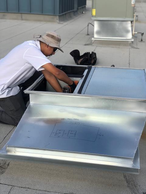 Las Vegas, NV - Installation of custom made sheet metal roof curb adapter for new install of rooftop AC unit.