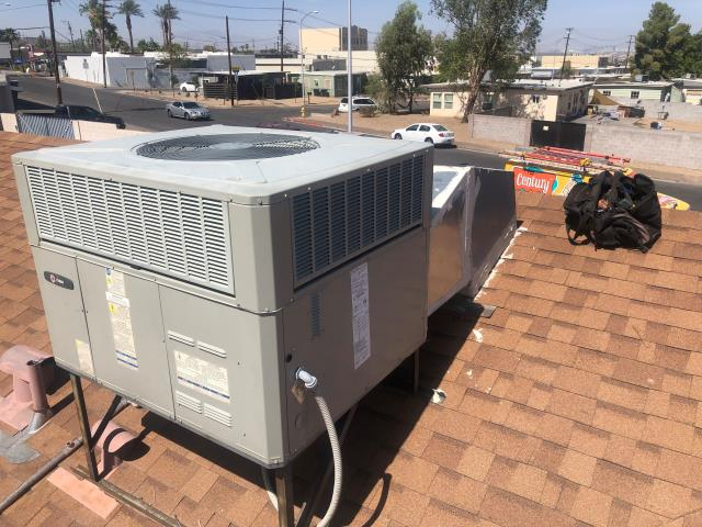 Install new indoor blower motor with new motor run capacitor and motor relay control for a 3 ton Trane brand 14 seer gas electric rooftop Air conditioning system.