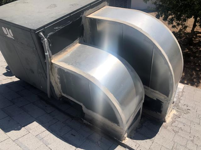 Las Vegas, NV - Fabricate and custom make sheet metal elbows for relocation of a Goodman 3 ton rooftop packaged heat pump AC unit R22 Freon