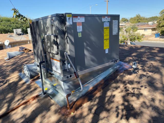 New installation of a 2.5 ton RUUD brand rooftop gas heat cool AC unit. Install custom factory roof curb stand. 10 year parts warranty included.