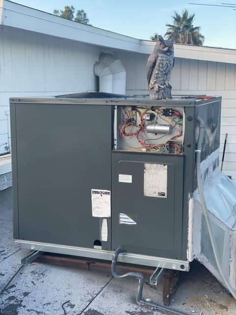Repair Goodman brand 4 ton rooftop heat pump AC unit. Install heat strips and clean blower wheel.