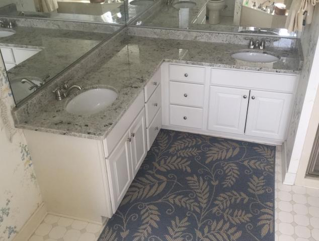 Henrico, VA - Colonial White granite countertop for all three bathrooms.  Client loves her Golden Crema kitchen granite countertop and decided to replace all three bathroom vanity tops.