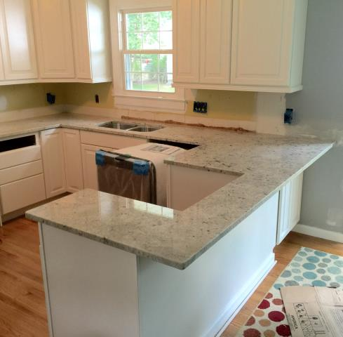 Henrico, VA - As always the Colonial White granite countertop looks great with any cabinets.  We are so happy to be a part of your kitchen remodel!