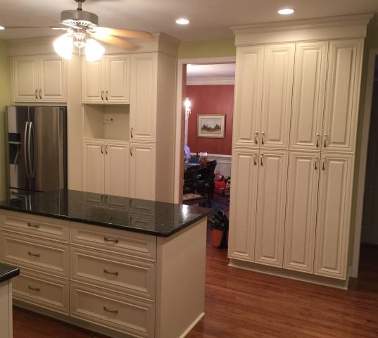 Mechanicsville, VA - It was wonderful working with my clients on their kitchen project.  It has been two years since we installed their bathroom cabinets and top.  The off white vanilla maple cabinets with the green butterfly looks amazing with their wood floor.