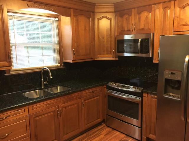 Charles City, VA - Traditional honey maple cabinets with green butterfly granite is always a nice combination! We hope our clients enjoy their new kitchen for years to come.