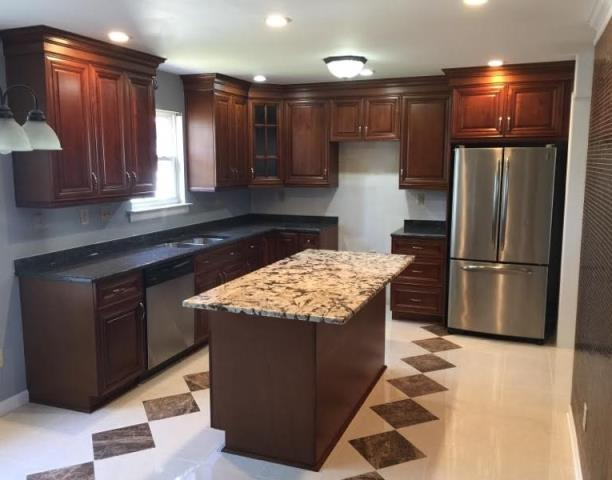 Richmond, VA - Our coffee maple cabinets paired with tan brown and delicatus granite offer a formal overall look especially when paired with our clients new tile floor.