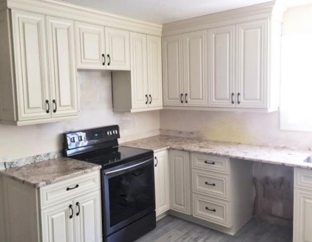 Richmond, VA - We love our vanilla cream maple cabinets with golden crema granite especially with our client's new gray floor!