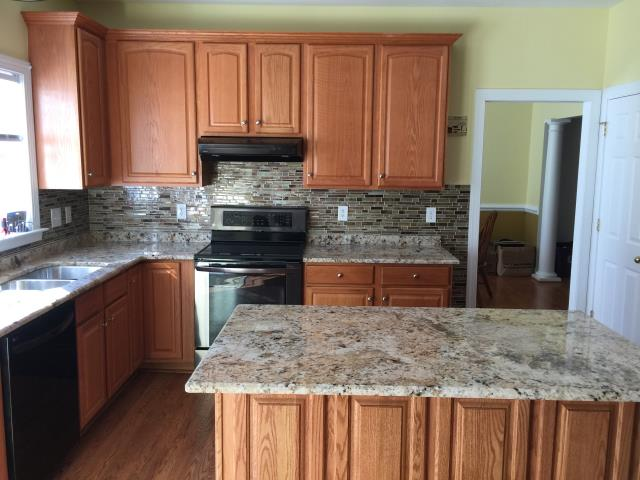 Richmond, VA - Golden Crema granite countertop with client's existing cabinets.  The Golden Crema looks great with any wood!!