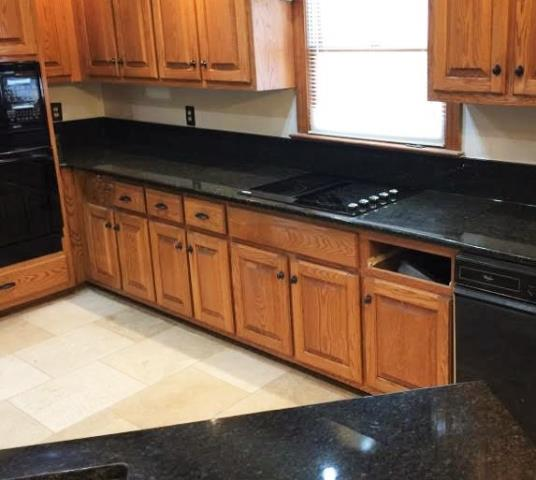 Mechanicsville, VA - A new Ubatuba granite top on these existing oak cabinets gives this kitchen new life.