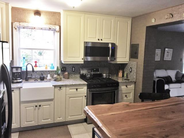 Richmond, VA - We love this kitchen! What a transformation! Our warm Vanilla Cream cabinets paired with our cool Azul Platino granite help create a neutral space which works well with our customers own rustic details.