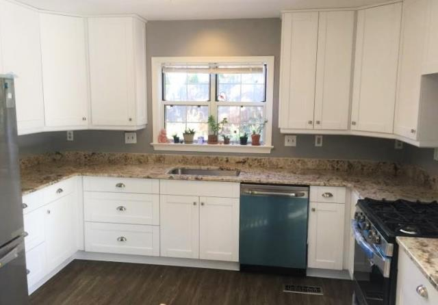 Charlottesville, VA - Our crisp White Shaker cabinets paired with our rustic and warm Golden Crema granite are a nice pair with our customers gray walls and wood floor. I really enjoyed collaborating with our Charlottesville customer!