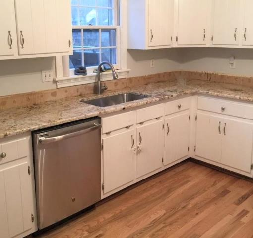 Midlothian, VA - Our Golden Crema granite works well with our customers own white cabinets and beautiful wood floors.