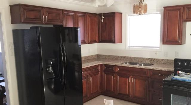 Richmond, VA - Our elegant Coffee Maple cabinets with Giallo Ornamental granite is a beautiful combination.
