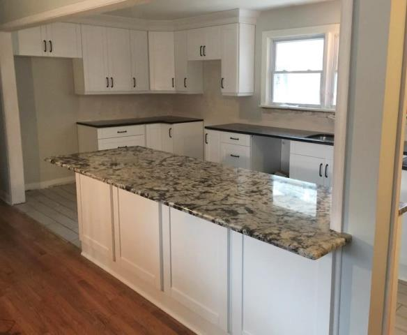Colonial Heights, VA - We love the final layout for this cooks kitchen with our white shaker cabinets, black pearl & delicatus granite!