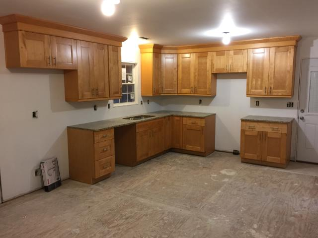 Petersburg, VA - Just completed this kitchen for my client with the double shaker maple cabinets paired with Azul Platino granite counter tops.
