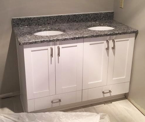 Midlothian, VA - Just installed another white shaker vanity with azul platino granite! We even added functioning drawers at the bottom of each sink base!