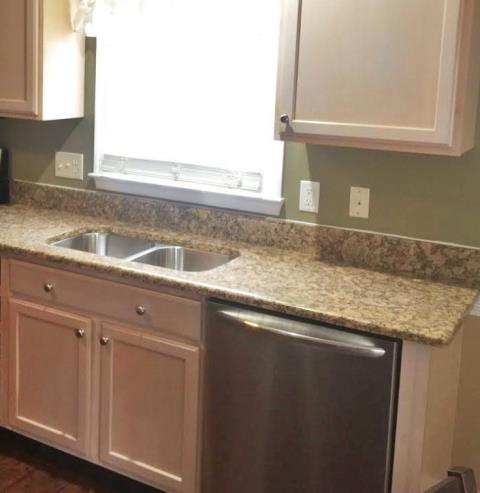 Colonial Heights, VA - We just installed this Giallo Fioritto granite top which we think is a perfect match with the customers existing maple cabients!