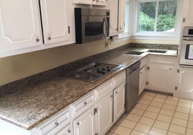 Richmond, VA - We really enjoyed watching this kitchen transform with the addition of Santa Cecilia granite on the customers freshly painted white cabinets.