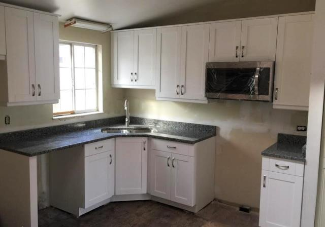 Richmond, VA - Just finished installing these white shaker cabinets with Azul Platino granite all in one day!