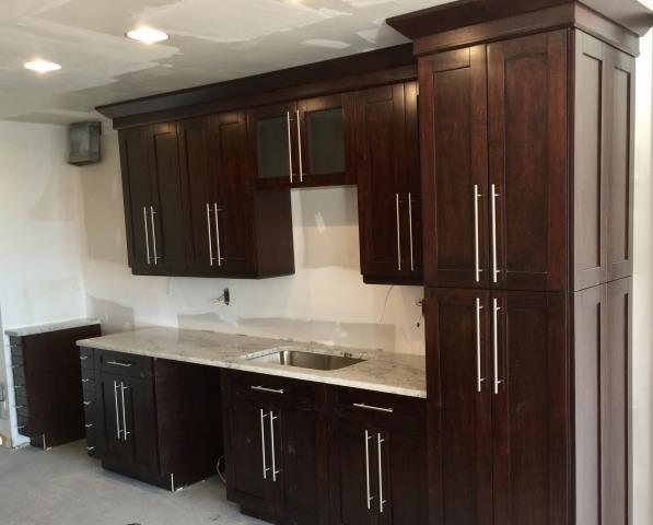Washington, DC - The espresso single shaker maple cabinets look amazing with the Colonial White granite counter top.  Can't wait for the tile backsplash to be installed.