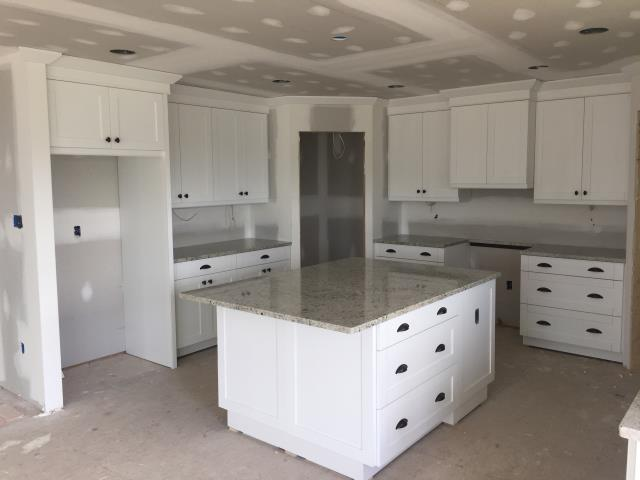 Deltaville, VA - This is a beautiful kitchen we completed on Monday.  White single shaker cabinets with Colonial White granite counter.  Can't wait to have photos of the completed kitchen with tile backsplash and flooring.