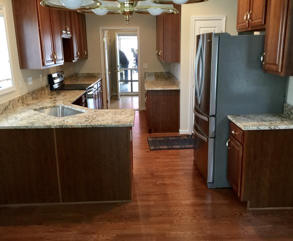 Glen Allen, VA - Our company installed a full kitchen for this client 10 years ago.  We have the pleasure again to installed this beautiful kitchen granite counter for their new house.