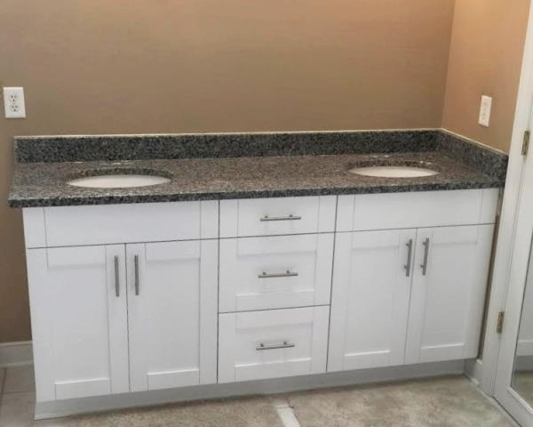 Moseley, VA - White Single shaker maple vanity cabinets with the Azul Platino granite top.