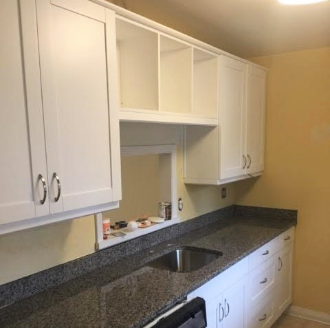 Midlothian, VA - We loved helping this return client update their cozy condo kitchen into a functional space using our popular white shaker cabinets and new caledonia granite!