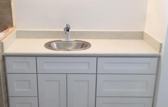 Moseley, VA - Just installed our clean & sparkly Crystal White quartz vanity top on our customers own white shaker vanity. Stunning!