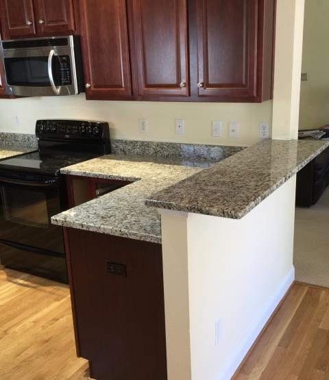 Moseley, VA - My client has used our cabinets and granite for her rental units in the past.  We are so happy to finally install granite for her kitchen counter.  The Venetian Ice looks perfect with her existing cabinets.