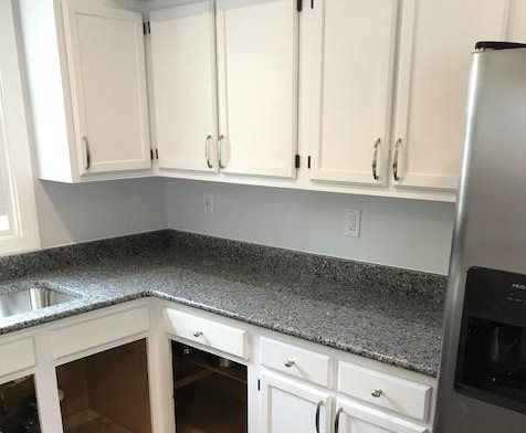 "Glen Allen, VA - We just finished installing this Azul Platino granite counter with a 4"" backsplash on our customers freshly painted existing cabinets. It looks great!"