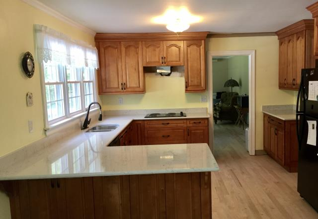 Midlothian, VA - We installed a kitchen granite counter for my client back in 2015.  So happy to work with them again on their new house.  This time we installed the honey maple cabinets with Cambria's Waverton quartz.  Our company is lucky to have so many return customers.
