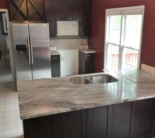 Richmond, VA - We absolutely love our Chocolate Shaker Cabinets with our Fantasy Brown Granite! We can't wait to see the finished kitchen with a tile splash!