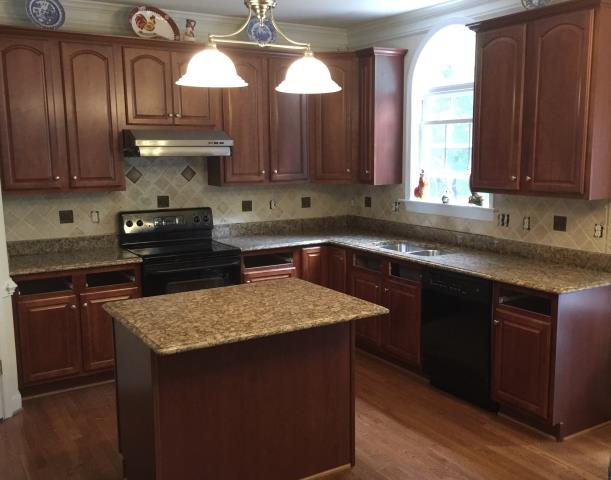 Chesterfield, VA - The Giallo Fioritto kitchen granite countertop with the premium ogee edge profile is a perfect match with my client's existing cabinets.