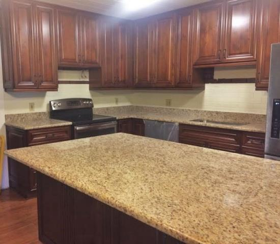 Glen Allen, VA - Just finished installing this classic kitchen using our coffee maple cabinets and giallo ornamental granite. These two always pair well together!