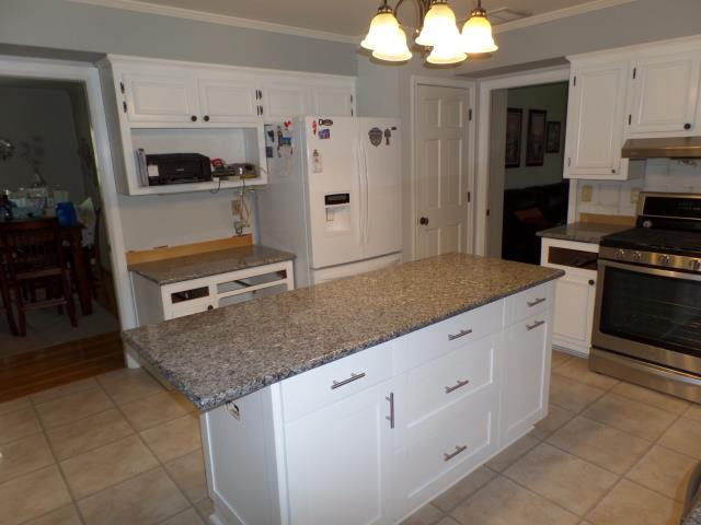 Colonial Heights, VA - We just installed this island cabinet with our in stock white shaker maple and Azul Platino granite for the whole kitchen.  My client is so happy with their selections.