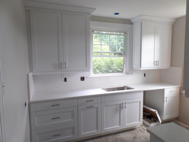 Richmond, VA - Another white shaker maple kitchen with the beautiful quartz counter and full quartz back splash.   Their lucky tenant will be moving into this gorgeous kitchen.