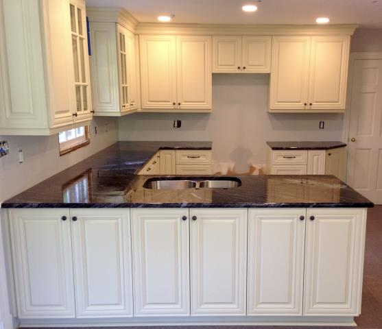 Richmond, VA - Our in stock vanilla white raised door panel looks spectacular with the Leland Blue honed granite counter.  Can't wait for the tile back splash to be installed.