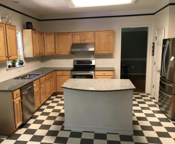 Glen Allen, VA - The installers just completed one out of 3 counter top installation for today.  The Caledonia looks great.