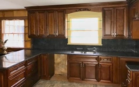 Richmond, VA - Just finished installing these rich Coffee Maple cabinets with a counter & full splash in our Tan Brown granite. We removed an overhead peninsula cabinet set and extended the back of the peninsula to allow for a new seating area.  What a difference!