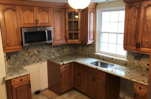 Richmond, VA - We just installed a custom order (Cream Beach granite) on our in-stock Honey Maple cabinets. The finished project is warm & elegant!