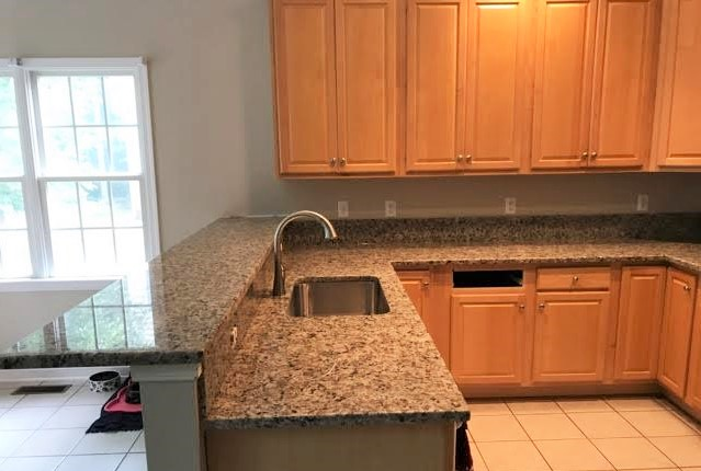 Midlothian, VA - This Yellow Butterfly granite was just installed on our customers existing maple cabinets to offer a soothing combination of colors in the kitchen.