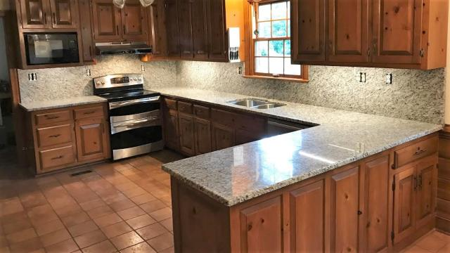 Mechanicsville, VA - We just finished installing this Venetian Ice granite with full backsplash on our customers current cabinets. The finished product gives the kitchen new life!