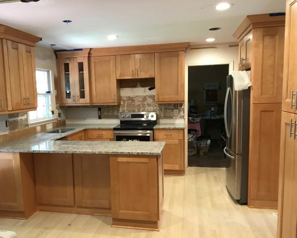 Richmond, VA - Double shaker maple cabinets with new caledonia granite for this kitchen we just completed today.  My client used the same cabinets for both bathrooms with a different called Azul Platino.