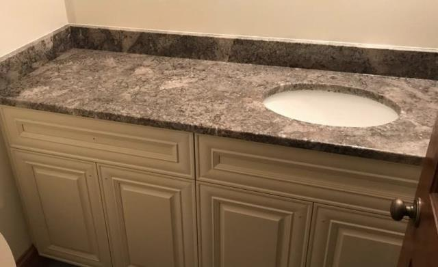 Quinton, VA - Just finished installing our Vanilla Raised panel vanity with our new Ganache granite. Perfect combination!