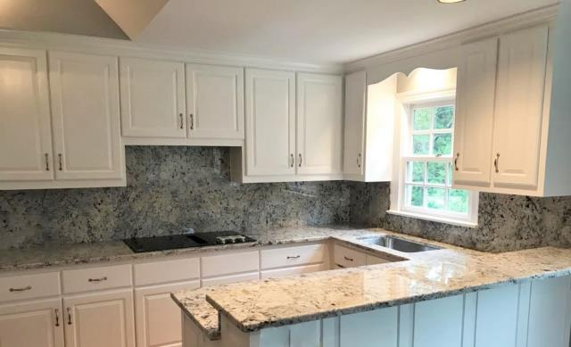 Richmond, VA - We just added this beautiful White Ice granite to our in-stock inventory. It looks fabulous with our customers existing white cabinets & freshly painted gray walls.