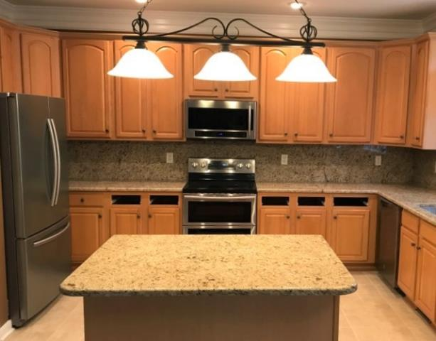Glen Allen, VA - Our in-stock Giallo Ornamental is warm and subtle on our customers counter and full backsplash.  The added little radius on the back of the island top the customer requested adds a softness to this already inviting kitchen.