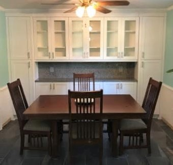 Richmond, VA - This beautiful dining storage unit along with matching kitchen cabinets and full splash was just installed.  This adds so much useful hidden storage as well as display glass cabinets. We love the finished custom look!
