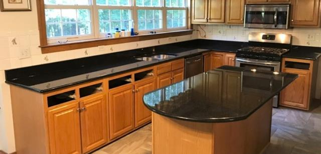 Chesterfield, VA - Our in-stock black pearl granite is the perfect match for our customers new tile floor and oak cabinets.