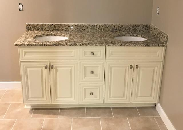 Richmond, VA - We love the soft and rich tones of our vanilla maple cabinet with our in-stock Venetian Ice granite. They look especially nice next to our customers floor tile and warm wall color.